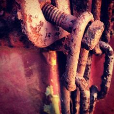 The chain on the back of a beautiful rusty old truck!