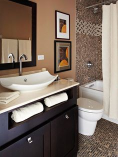 Brown + Black is no longer a faux pas. Love that they pulled the sink drawers out to store towels, love the sink, love the mismatching-but-not frames, and the shower tile.