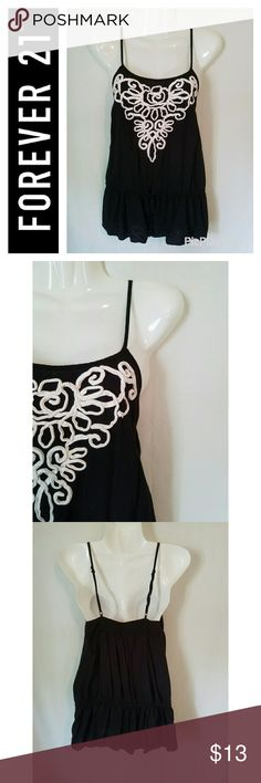 Forever 21 Black RIbbon Embroidered Tank Top Great used condition. Forever 21 black tank top with ribbon embroidery design. Drawstring waist provides a flattering fit. Adjustable straps. Forever 21 Tops Tank Tops