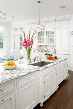 Elegant White Kitchen Cabinets - the detail work  in front of the sink is to die for!