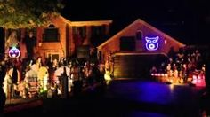 Awesome Halloween house light show set to Fall Out Boy's My songs know what you did in the dark (Light Em Up) song....