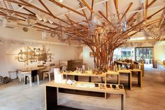 Tree in middle branching out, hang jewelry and purses from branches Shop Interior Design, Retail Design, Interior Design Inspiration, Interior Decorating, Design Ideas, Coffee Cafe Interior, Jewelry Store Design, Tree Interior, Plafond Design