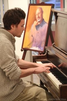 Patron plays the piano in the North Gallery