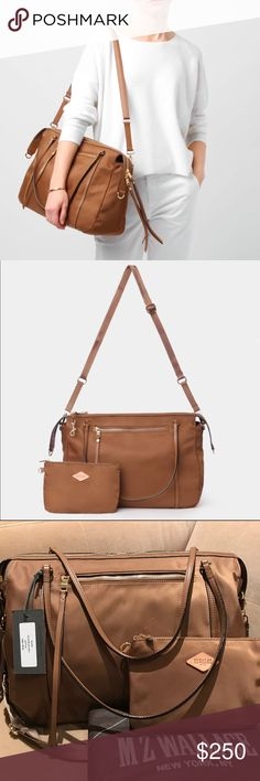 """MZW Willow -Tiger Eye Bedford MZW Willow -Tiger Eye Bedford   Pristine! Brand new!  Amazing large, light weight carry-all in beautiful Tiger Eye Bedford nylon!  Double leather handles; Detachable adjustable crossbody strap Zip top closure; Lined  1 exterior zip pockets, interior zip compartment, 2 interior slip pockets, card slot, 2 cell phone pockets Zippers have great long leather pulls Removable zip pouch  16""""W x 6""""D x 10.5""""H; 8"""" shoulder strap drop, 22"""" strap drop MZW Signature Gold HW…"""