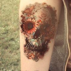 http://tattoomagz.com/watercolors-skulls-tattoos/flower-eyes-watercolor-skull-tattoo/