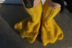 """i don't even know what to do with these """"knitted duck foot leg warmer slippers""""... other than, you know, buy them for kyle. $69.99"""