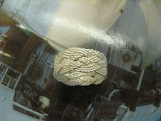 Hand-tied twisted silver Turks Head Knot ring