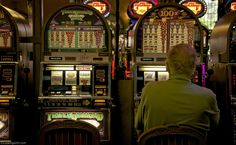 "Looking With An Old Gambler At a slot machine (American English), informally fruit machine (British English), the slots (Canadian English), poker machine or ""pokies"" (slang) (Australian English and New Zealand English) or simply slot (American English) is a casino gambling machine with three or more reels which spin when a button is pushed!  #LookingWith #LasVegas #Nevada #USA http://www.lookingwith.com/home/photo/58"