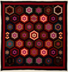 "Mennonite Hexagons Quilt: Circa 1870; Pennsylvania.  Almost entirely made of fine wools with a few scattered pieces of velvet. The back is a chestnut colored wool. It is in excellent condition; measurements are 76"" x 79""."