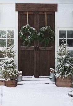 simple greenery winter outdoors doors snow wreaths tress unadorned pine