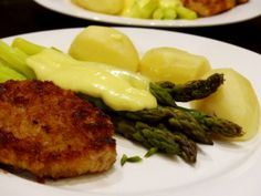 Entrée - Schnitzel and potatoes with green asparagus and Sauce Hollandaise.