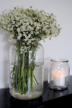 White wild flowers and white candles