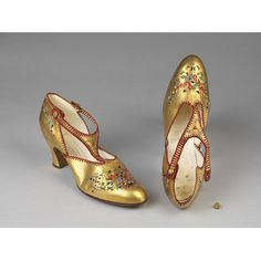 Monaco ca 1925 A. Rambaldi .  Golden kidskin with small painted flowers in red, blue, yellow and gold. It has a heel of medium height and a T-bar across the instep, stitched with a red silk cord. It fastens with a round golden button.