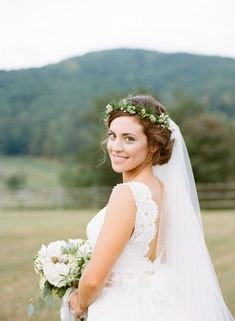 trending bridal hairstyle with flower crown and veil