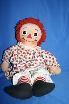 Raggedy Ann. This looks like the one my mom has. Mine has blue flowers on her dress.