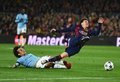 David Silva of Manchester City brings down Lionel Messi of Barcelona during the UEFA Champions League Round of 16 second leg match between Barcelona and Manchester City at Camp Nou on March 18, 2015 in Barcelona, Spain.