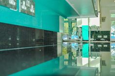 Aqua Green Splashback by CreoGlass Design (London, UK). Crystalline Collection has been designed to highlight the three-dimensional textures of the raw compounds, pigments and glitters. View more glass kitchen splashbacks on www.creoglass.co.uk #kitchen