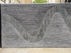 Natural Stacked Slate Slabs to create a meandering River Wall in London by Andy Goldsworthy