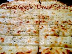 Cheesy Garlic Bread with homemade pizza dough!  Does not require a rise time, but bakes nice and soft and puffy.  My new standby pizza and breadstick recipe!