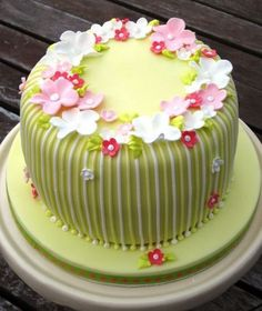 green birthday cake decorating with flowers
