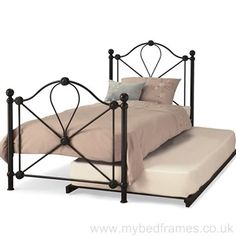 Wood and Wrought Trundle Bed Frame for Inspiring Bed Material Ideas: Antique Bedroom Furniture Design With Black Wrought Iron Frame And Elegant Bedding Plus Mattress Also Decorative Throw Pillows