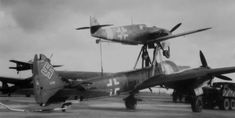 Captured Mistel 1 - Messerschmitt Bf + Junkers Ju with a cumulative warhead. * Mistel (training - in the background on left) - Focke-Wulf Fw + Junkers Ju Source: ©USAF. Ww2 Aircraft, Fighter Aircraft, Aircraft Carrier, Military Aircraft, Fighter Jets, Luftwaffe, Focke Wulf, Aircraft Design, World War Two