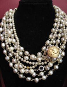 I collect chanel buttons.  Here are  a pear and crystal necklaces where I added a Chanel button.