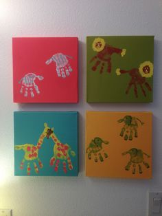 Handprint animals for our jungle themed bathroom. The colorful canvases and paint came from Red Envelope. Don't know if they still sell the kit. We have zebras, lions, elephants and giraffes. These are in the kids' bathroom.