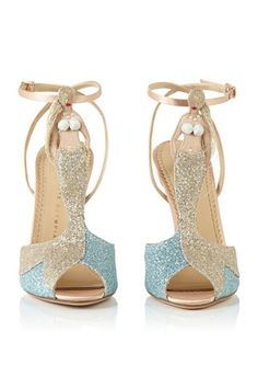 I can't believe I am actually pinning this but what can I say? I love a mermaid!  Charlotte Olympia spring 2014 shoes