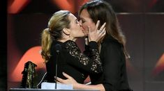KATE Winslet locked lips with West Wing star Allison Janney for a kiss on stage at the Hollywood Film Awards last night. The actress was on stage to pick up a prize for her Woody Allen film Wonder … Kate Winslet, Woody Allen, Hollywood Actor, Hollywood Actresses, Titanic, Marie Claire, Surprise Kiss, Allison Janney, Star Wars Facts
