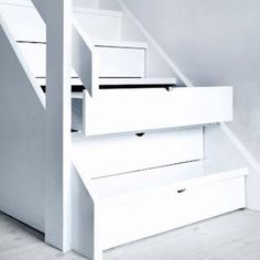 If an entire staircase as done in drawers it would add so much storage!  Perfect for holiday decorations.