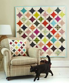 Cathedral Windows quilt and Cathedral Windows cushion by Jo Avery for Love Patchwork & Quilting issue 6 Photo © Love Patchwork & Quilting