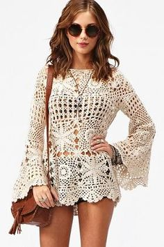 Vintage-inspired cream crochet dress featuring bell sleeves and a scalloped hem. Bateau neckline, loose fit. Looks perfect tossed over a bik...