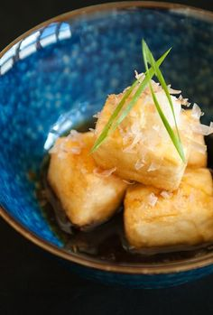 Agedashi-dofu 揚げ出し豆腐 - Tender, silky tofu with a crisp fried coating in a small pool of dashi-based broth. Grated ginger, daikon radish, and bonito flakes to serve on top. Tempeh, Vegetarian Recipes, Cooking Recipes, Healthy Recipes, Japanese Appetizers, Japanese Dishes, Japanese Food, Japanese Tofu Recipes, Gastronomia