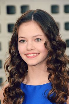 Mackenzie Foy inspiration for Mel but with brown eyes and darker hair.