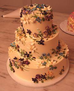 A delicately decorated Violet wedding cake. #Dessert #Cake #Weddings