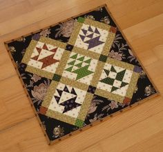 Looking for quilting project inspiration? Check out Mini quilt with baskets by member sylfel. - via @Craftsy
