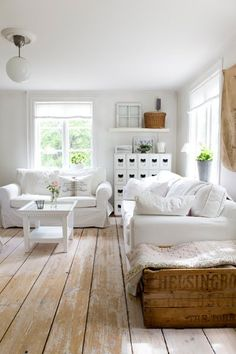 white furnishings + rustic plank floors