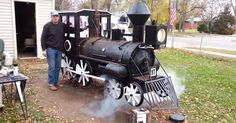 """Steve, a retired iron worker from Illinois, built this awesome backyard BBQ steam engine smoker over the course of three years. According to his son, """"the fire box is from an old farm house wood stove and the wheel rims are from cut up fence posts. He built the water tank and whistles himself…"""