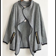 Long Sleeve Cardigan  Long sleeve cardigan with gold zippers Very thick material with leather trim  No trades/ No holds but open to negotiations  Sweaters