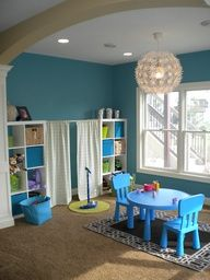 """Playroom with curtained """"stage"""" and microphone. This was my dream playroom as a child!. R toys/bears L dress up area plus kitchen, slide, and swing...yellow walls and chalkwall"""