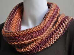 Easy Ridged Cowl. Knits up fast with chunky yarn. Garter stitch edging with occasional garter stitch or purl ridges.