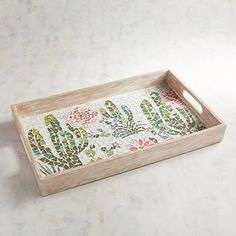 For a modern take on southwestern style, our handcrafted glass and mirror mosaic tray features desert elements and a weathered wood frame. Use it to serve refreshments or as a display piece for your coffee table or built-in shelves.