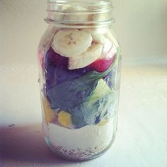 My everyday smoothie pre-made; oats, almonds, protein powder, Greek yogurt, a mango, spinach, a green apple, blueberries, strawberries, and a banana! Just a splash of almond milk and it's perfect :)