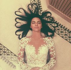 "Kendall Jenner wears a white lace ""nude"" dress"