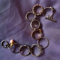Another Pinterest inspired project! These 9 rings all have special meaning but have been sitting in my jewelry box for years.  Linked them together with jump rings, added a heart clasp and, voila, a bracelet!  I get so many compliments every time I wear it.