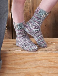 These socks are crocheted from the top down and can easily be made to fit any member of the family! (except for the family pet) (Patons Yarns)