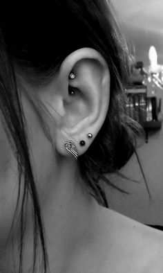 cute double helix piercing combinations - I love that...May do it...I took out my tongue piercing and this would be an elegant yet badass replacement piercing...