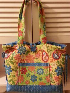 Bow Tucks Bag purse plenty of pockets....bright colors ....excellent Christmas gift. $35.00, via Etsy.