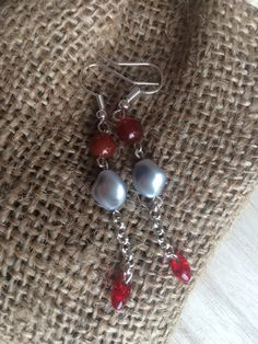 A personal favourite from my Etsy shop https://www.etsy.com/uk/listing/266798375/red-silver-dangle-earrings-gift-for-her
